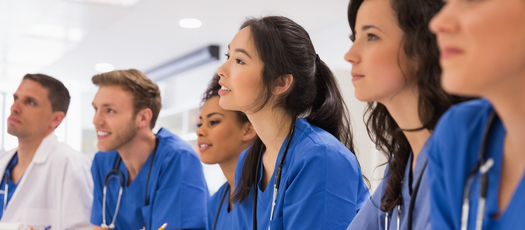 rsz_medical-students-listening-sitting-at-desk-picture-id532548555